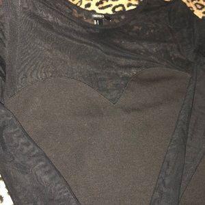 Mesh top black mini dress.